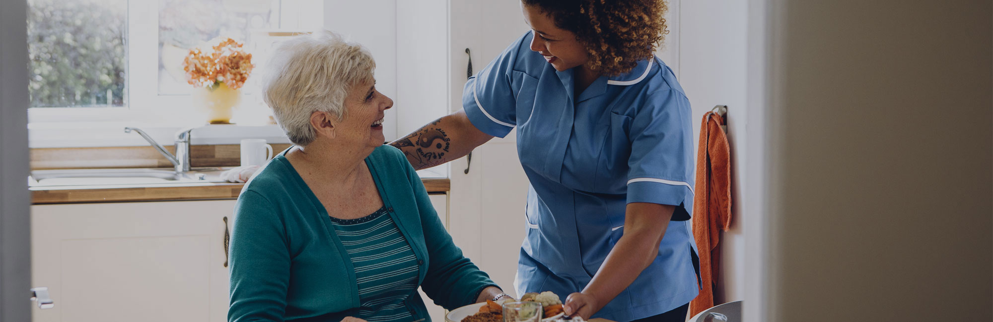 Care home worker with female resident